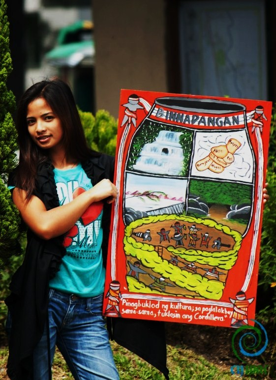 Winner of the Poster Making Contest, modeled by a Binnadangan